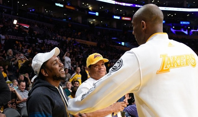 Kendrick Lamar (L) talks to Kobe Bryant at a basketball game between the Houston Rockets and the Los Angeles Lakers at Staples Center on January 17, 2016 in Los Angeles, California