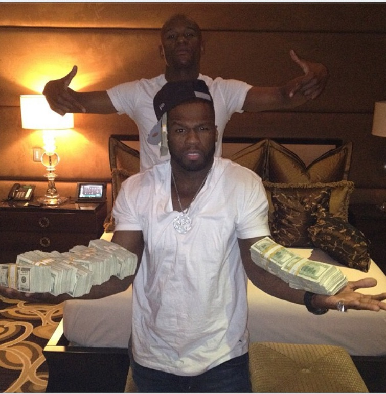 50 cent says that floyd mayweather still owes him a chunk of money for his promotions company almost 2 million to be