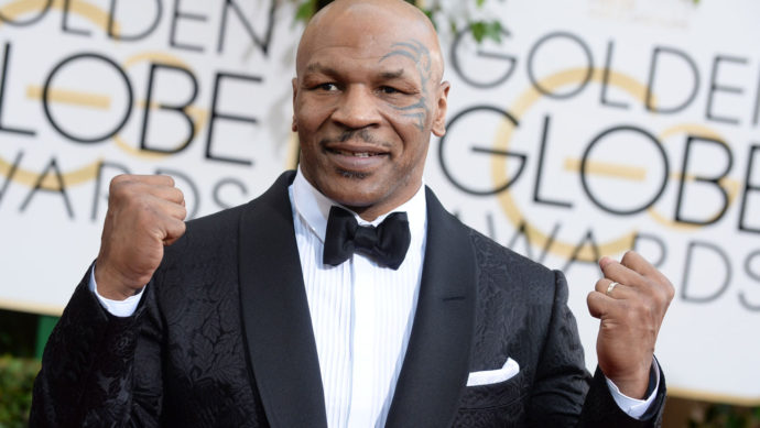 Mike Tyson arrives at the 71st annual Golden Globe Awards at the Beverly Hilton Hotel on Sunday, Jan. 12, 2014, in Beverly Hills, Calif. (Photo by Jordan Strauss/Invision/AP)